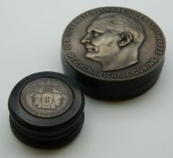 Two snuff boxes decorated Nazi emblems. The largest 7.5 cm diameter.