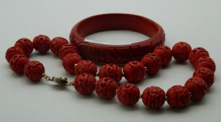A Chinese necklace and a Chinese bangle. The former 36 cm long.