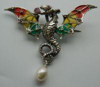 A silver plique-a-jour dragon brooch. 6 cm wide.