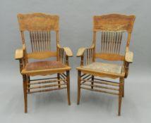 A pair of American oak open armchairs. 60 cm wide.