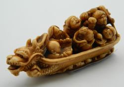 A 19th century carved ivory boat form okimono. 7 cm long.