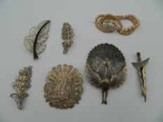 A collection of silver brooches, etc.