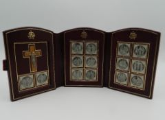 A folding leather cased Stations of the Cross. 11.5 cm high.