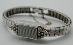 A 14 ct white gold and diamond Lafemme ladies wristwatch. 1 cm wide. 22.2 grammes total weight.