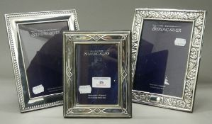 Three modern sterling silver photograph frames. The largest 17.5 cm x 22 cm.