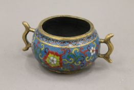 A Chinese cloisonne decorated bronze censer. 16 cm wide.