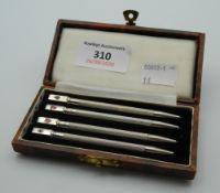A cased set of silver bridge pencils. Each 8.5 cm long.