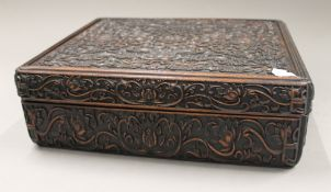 A Chinese carved hardwood box. 36 cm wide.
