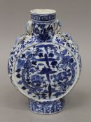 A 19th century Chinese blue and white porcelain moon flask. 21.5 cm high.