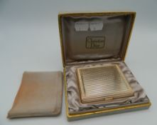 A Christian Dior compact, boxed. The box 13.5 cm wide.