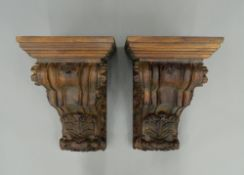 A pair of carved wooden corbels. Each 52 cm high.