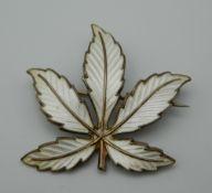 A Norwegian enamel leaf form brooch. 4.5 cm high.