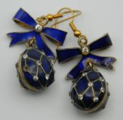 A pair of silver and enamel egg form earrings. 3 cm high.