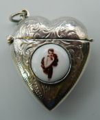 A silver heart shaped vesta decorated with a lady. 4 cm high.