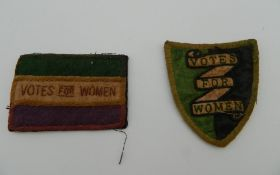 Two small Vote for Women suffragette type cloth patches, one shield shaped, the other rectangular.