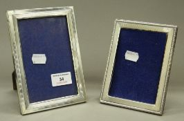 Two silver photograph frames. The largest 12 cm x 17 cm.