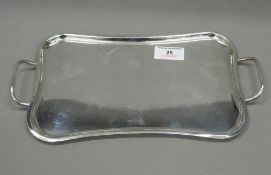 A small 900 silver tray. 29.5 cm wide. 8.9 troy ounces.