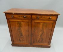 A Victorian mahogany side cabinet. 102.5 cm wide. The property of Germaine Greer.