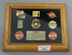 A boxed and framed Coca Cola badge set, Nostalgia 2 limited edition No 1876/2500. 21.5 cm wide.