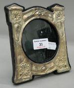 An Art Nouveau silver photograph frame. 14 cm x 15.5 cm.