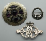 Three various Antique Scottish silver brooches. The largest 6.5 cm diameter.