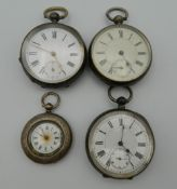 Four silver cased pocket watches. The smallest 4 cm diameter.