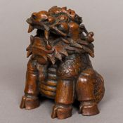 A 19th century Chinese bamboo carving Formed as a Qilin modelled seated. 14 cm high.