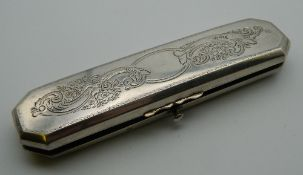 A 19th century Continental silver spectacle case and a pair of spectacles. 13 cm long.