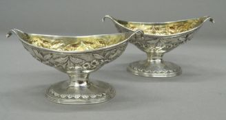 A pair of Scottish silver pedestal navette shaped salts, with gilt interiors, Edinburgh 1833,