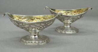 A pair of Scottish silver pedestal navette shaped salts, with gilt interiors, Edinburgh 1833,