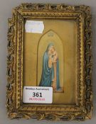 A small 19th century Continental print of The Madonna and Child, framed and glazed.