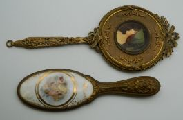 A Palais-Royal hand mirror and a porcelain mounted hand mirror.