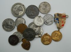 A collection of Royal medallions, including Victoria,
