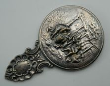 A Danish silver plated hand mirror.