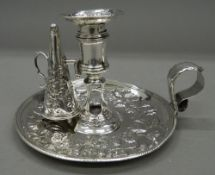 A mid-18th century silver chamberstick and snuffer. 9.5 cm high. 12.