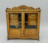 A Victorian smoker's cabinet. 56.5 cm wide.