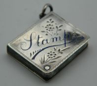An enamel decorated silver stamp box. 3 cm high.