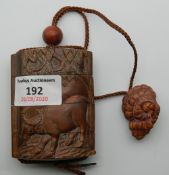 A carved wooden inro. 8 cm high.