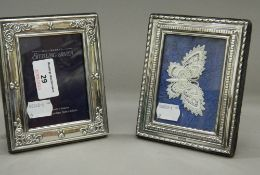 Two small silver photograph frames. Each approximately 10.5 cm x 13 cm.
