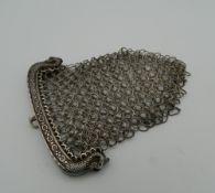 A Georgian silver purse, hallmarked for Birmingham 1790. 7 cm wide. 31.1 grammes.