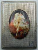 A silver cigarette case decorated with a nude lady. 805 cm wide. 190.7 grammes total weight.