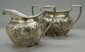 A silver sugar bowl and a matching cream jug. The former 16.5 cm wide. 11.3 troy ounces.