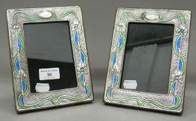A pair of silver Art Nouveau style photograph frames. 14.5 cm x 19.5 cm.