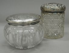 Two silver topped dressing jars. The largest 10.5 cm high.