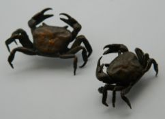 Two small Japanese bronze model crabs. The largest 4.5 cm wide.