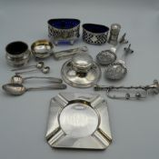 A quantity of small silver items, including salts, inkwell, etc. 9.7 grammes of weighable silver.