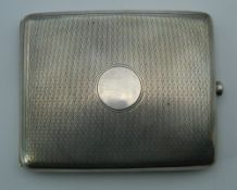 A silver cigarette case, hallmarked for 1927. 10 cm wide. 4.6 troy ounces.