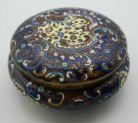 A cloisonne enamel box. 9 cm diameter.