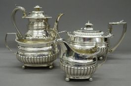 A matched Georgian silver four piece tea set. The teapot 28.5 cm long. 61.