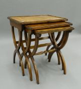 A nest of three mahogany tables. 56 cm wide.